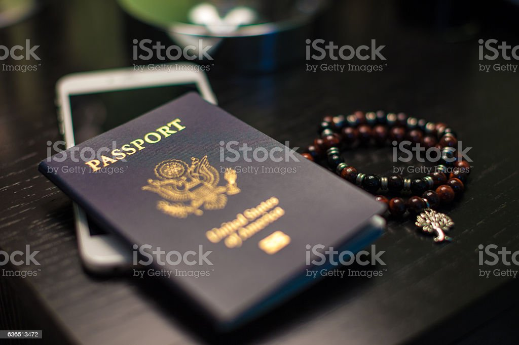 closeup of passport and belongings stock photo