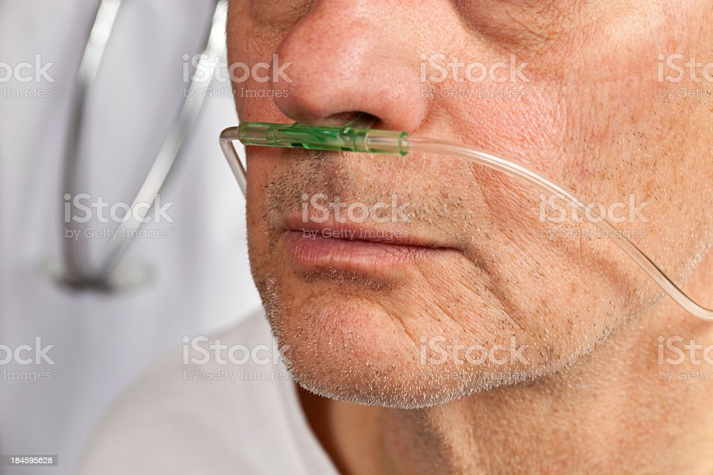 Close-up of patient's face with breathing tube in nose stock photo