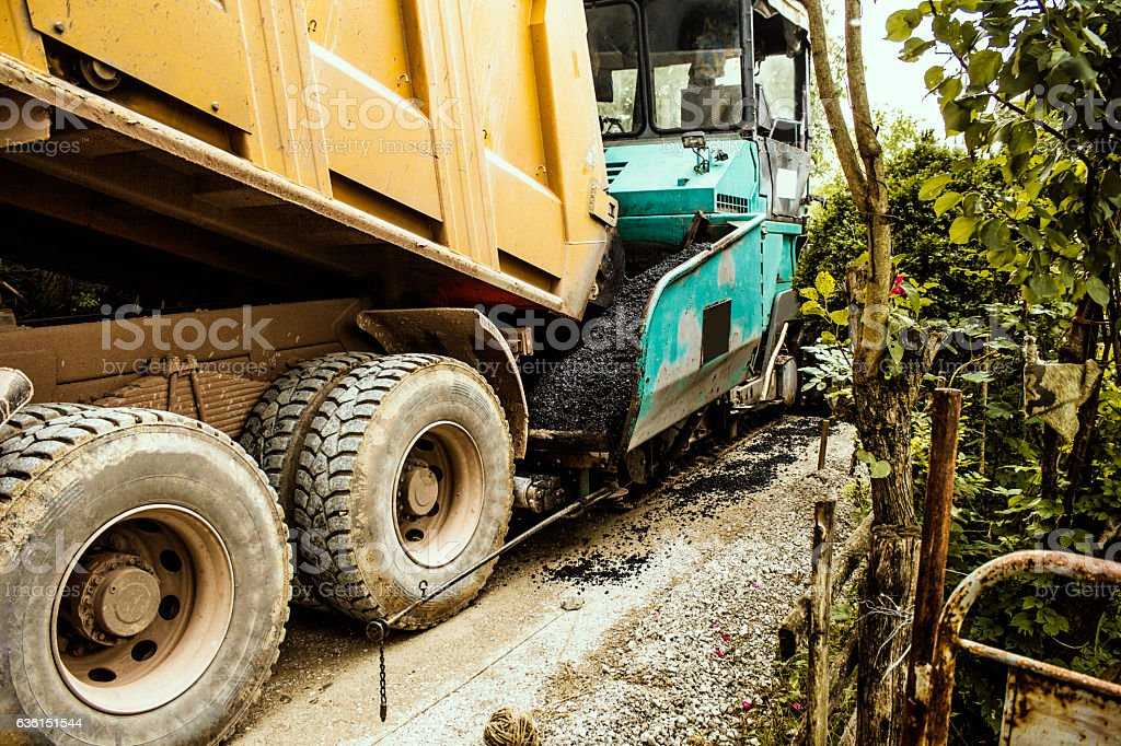 Closeup of pavement paver in a road construction site. stock photo