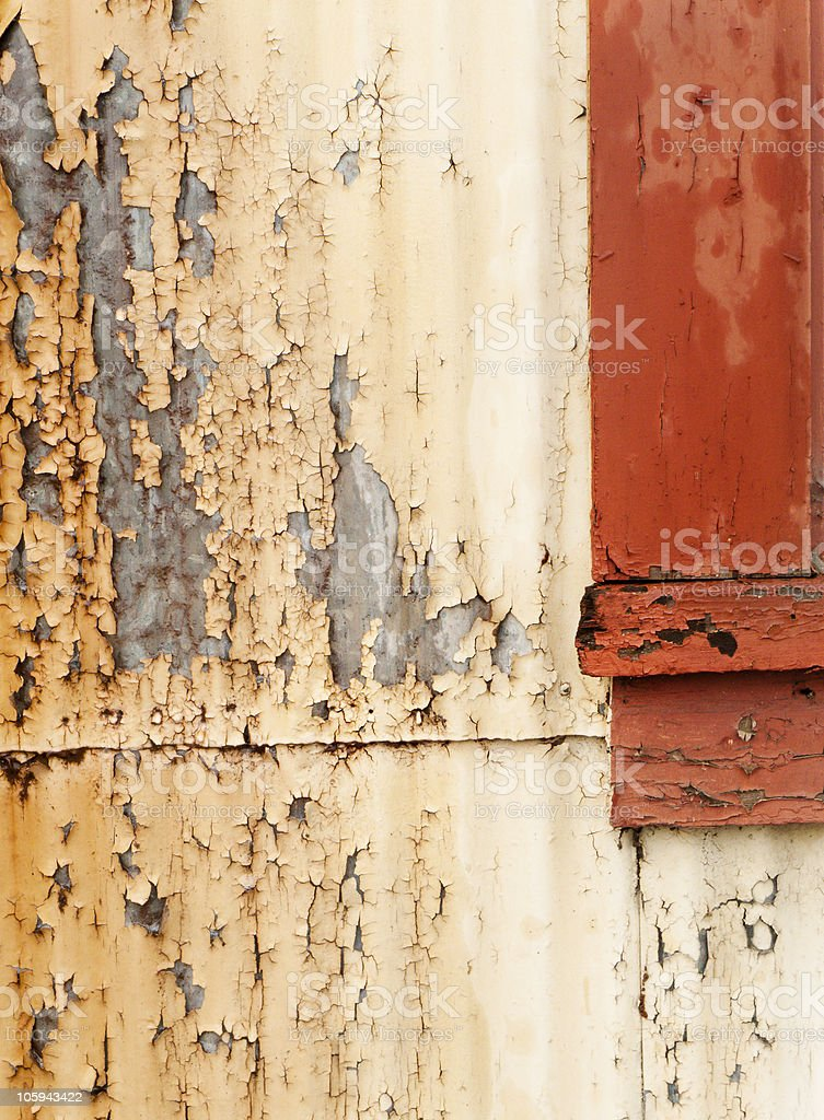 Close-up of peeling paint on metal and wood stock photo