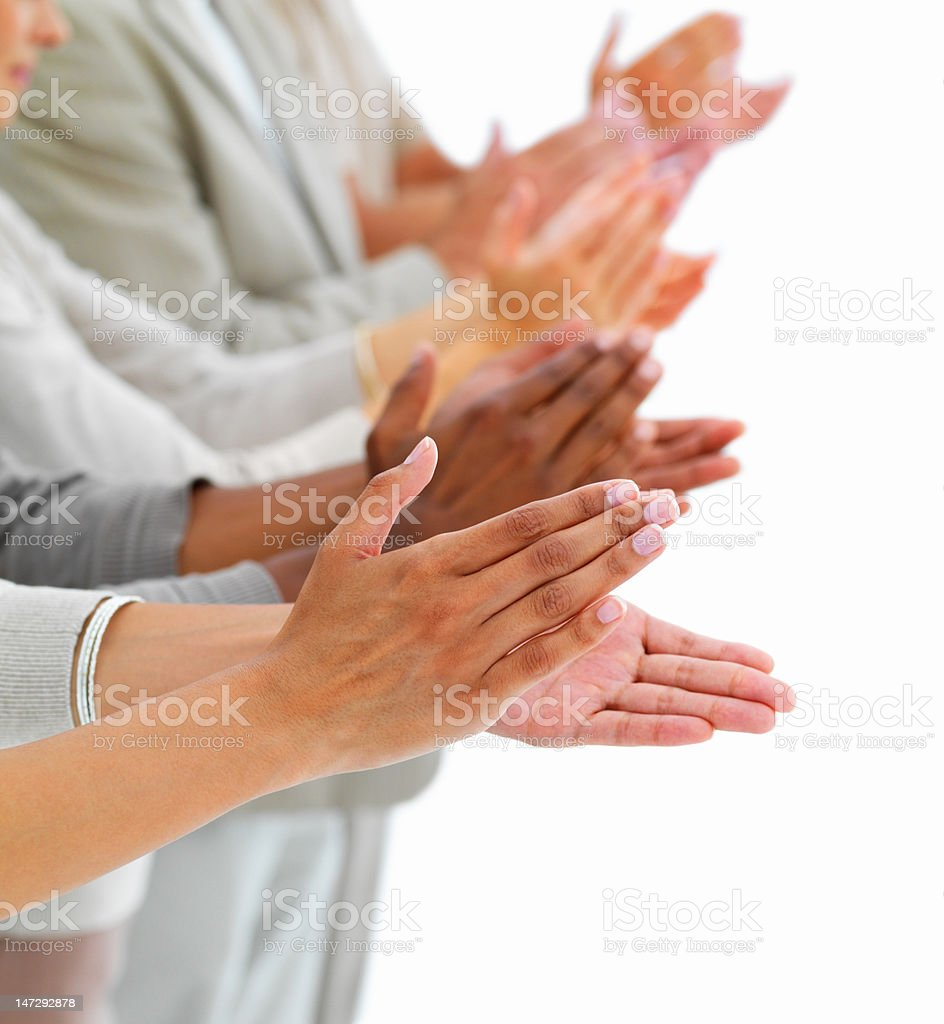 Close-up of people clapping hands stock photo