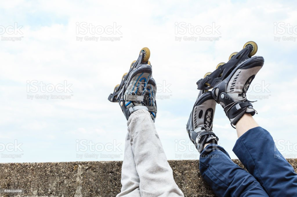 Closeup of people friends with roller skates. stock photo