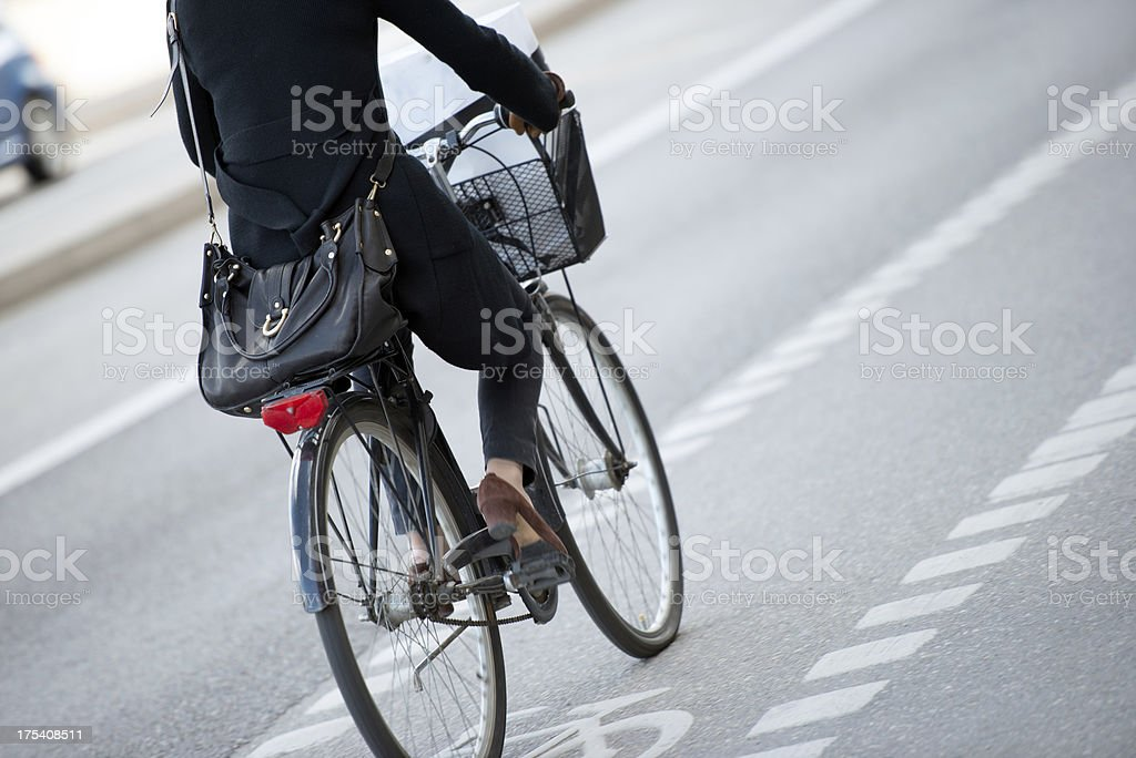Close-up of person biking to work royalty-free stock photo
