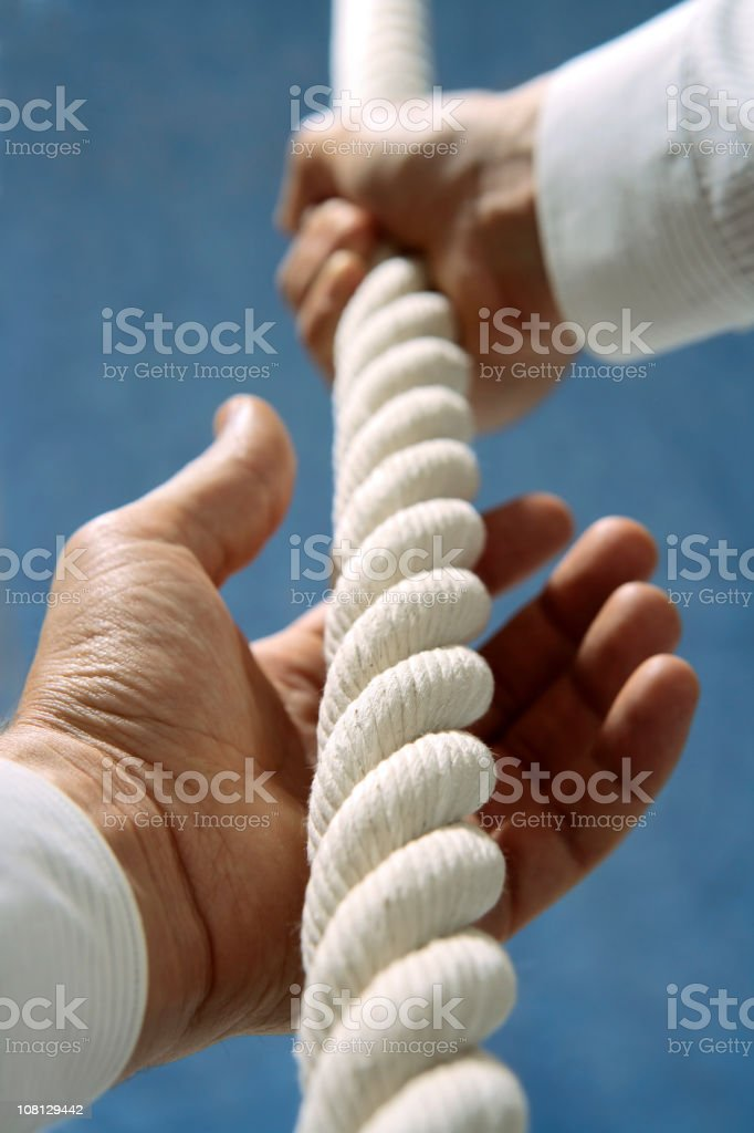 Close-up of Person's Hands Climbing Rope royalty-free stock photo