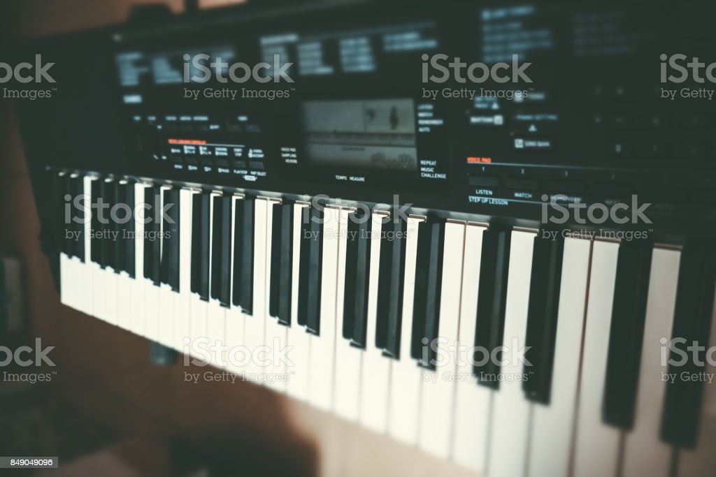 Close-up of piano or Electronic musical keyboard synthesizer stock photo