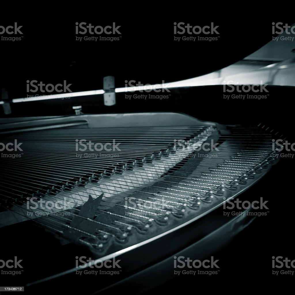 Close-up of piano strings and hammer with black background stock photo