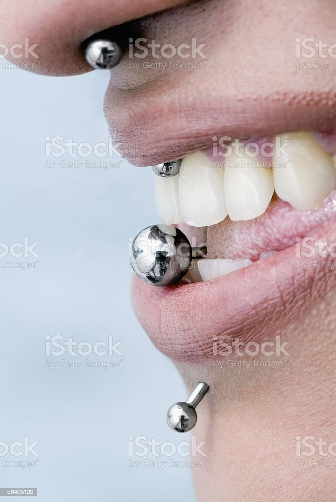 Close-up of piercing on a woman's face stock photo