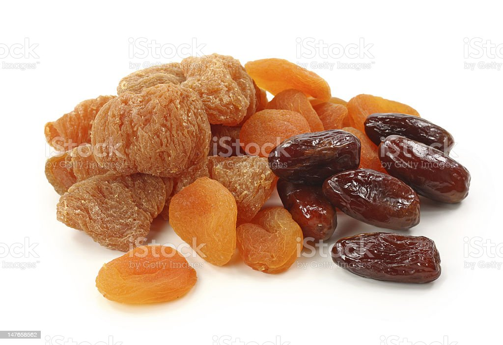 Close-up of pile of dried fruits against a white background royalty-free stock photo
