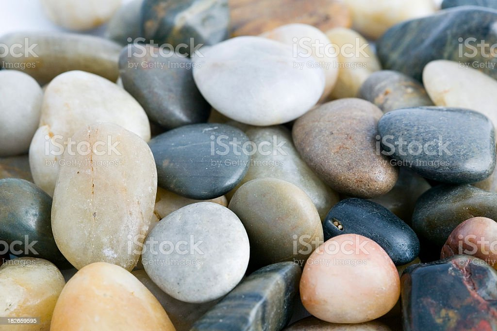 Close-up of pile of polished river stones in neutral tones stock photo