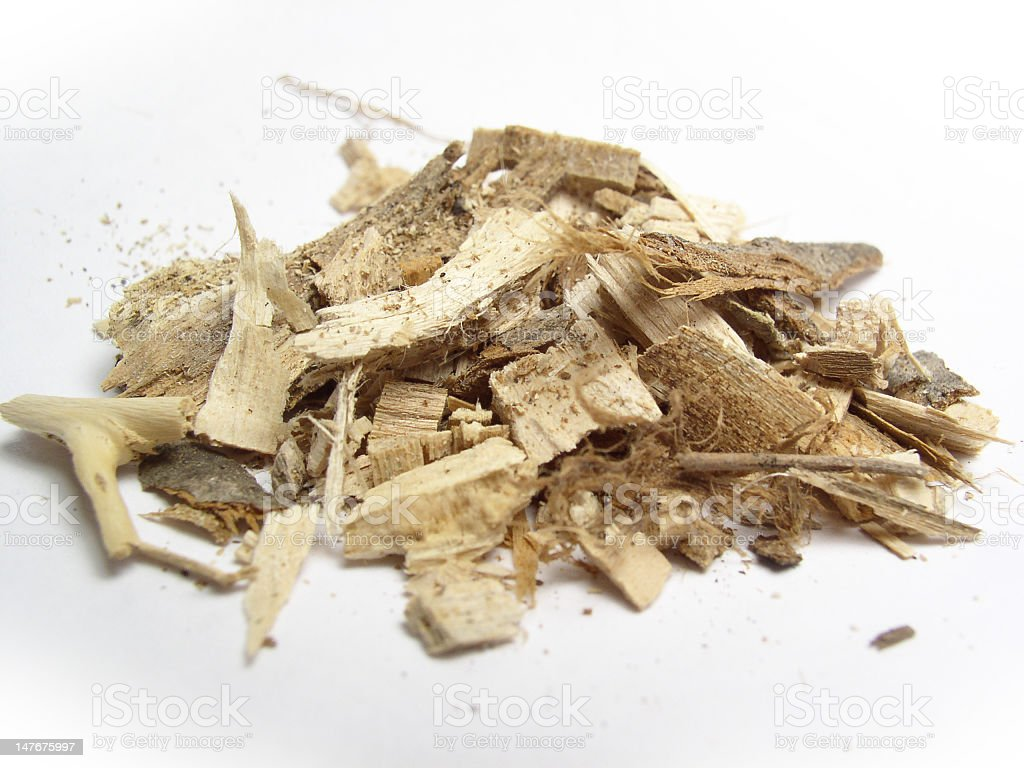 Close-up of pile of tan wood chips and bark on white stock photo