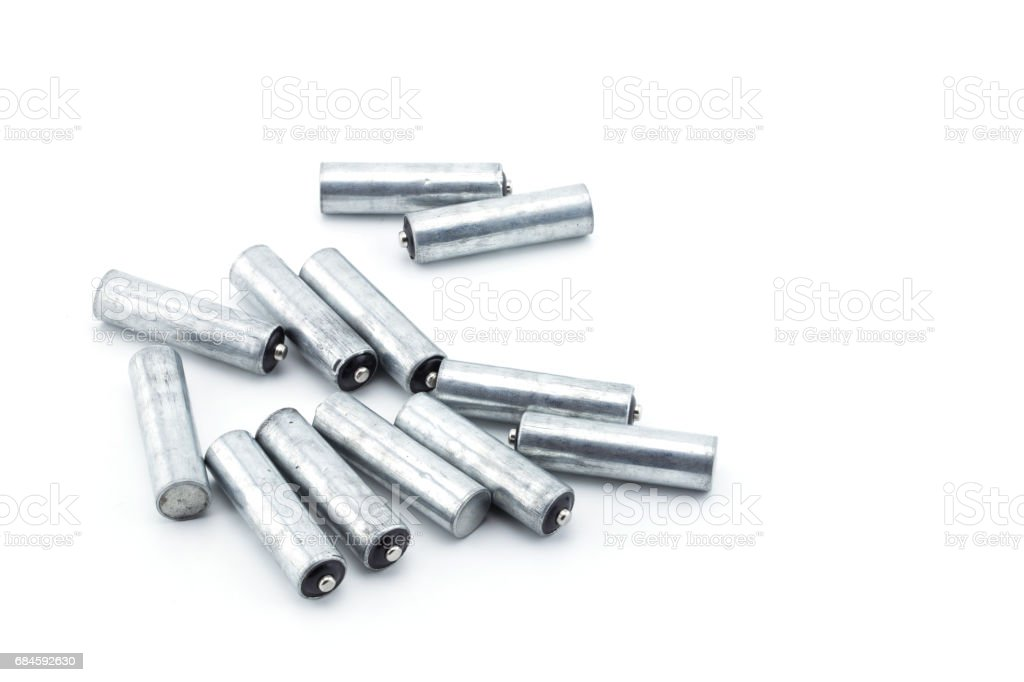 Closeup of pile of used alkaline batteries. Alkaline battery aa size Several heap batteries. stock photo