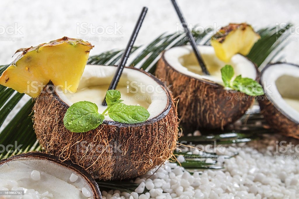 Closeup of pinacolada with mint leaf in the coconut stock photo