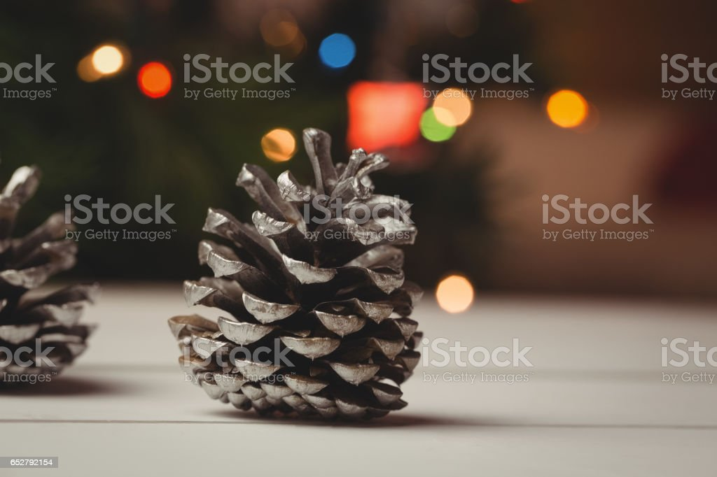 Close-up of pine cone on wooden table stock photo