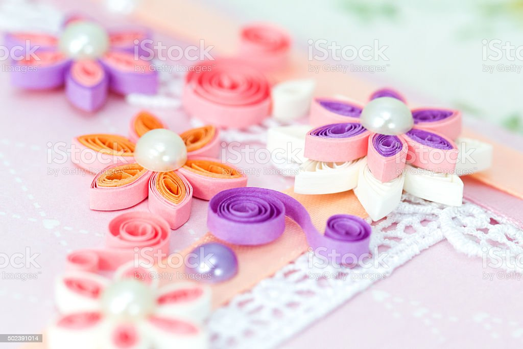 Closeup of pink quilling paper flowers stock photo