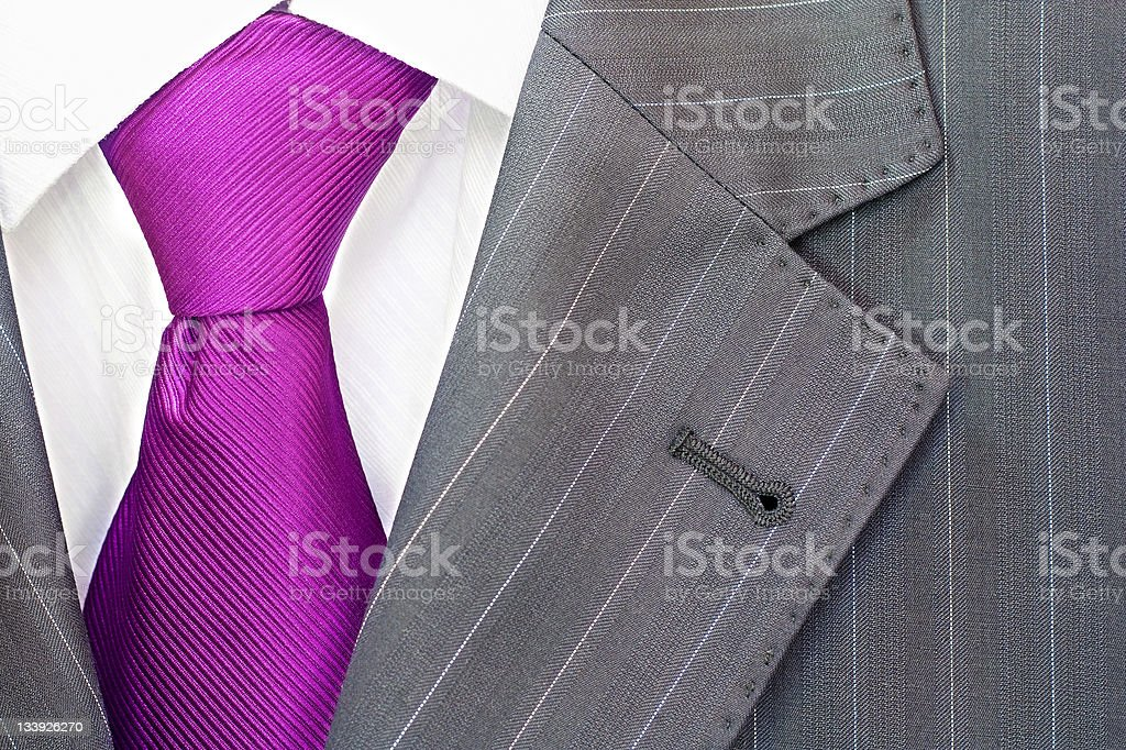 Closeup of pinstriped men's suit with bright fuchsia tie royalty-free stock photo