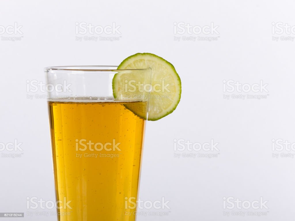 Closeup of Pint Glass of Beer with Lime on Rim Offset for Copy stock photo