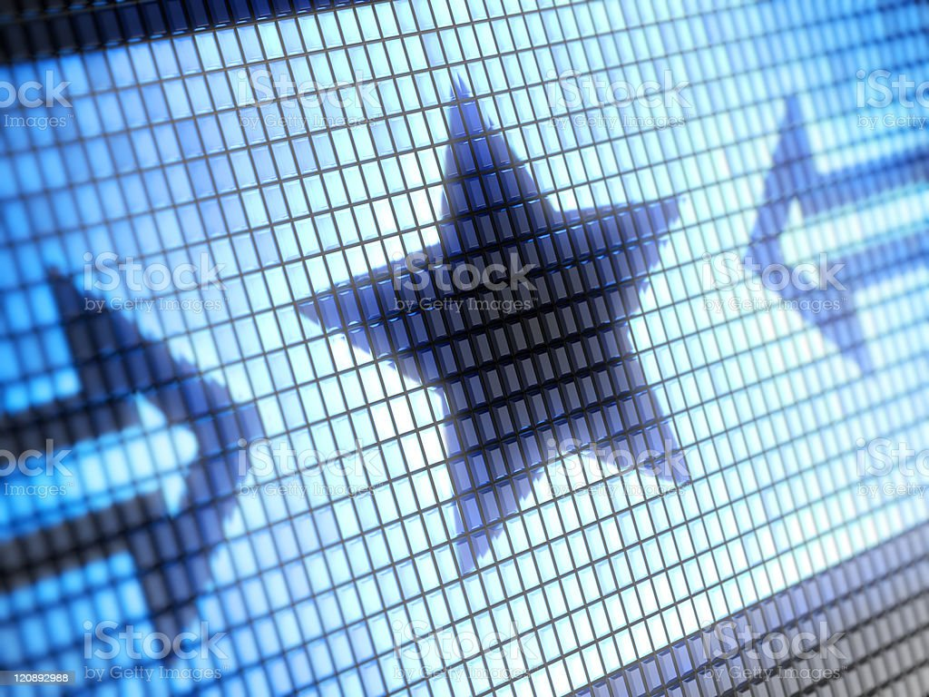 A close-up of pixelated arrows pointing at star on a screen royalty-free stock photo