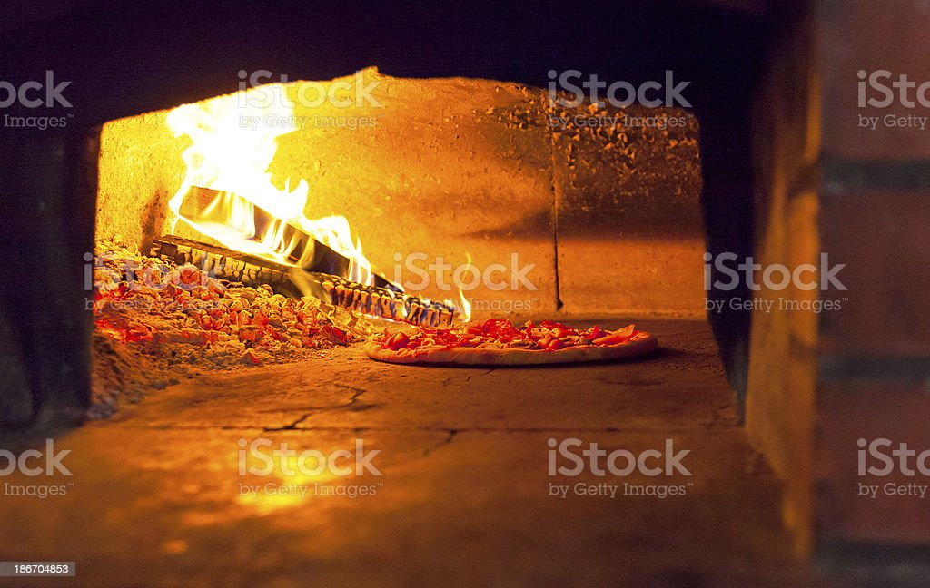 Closeup of pizza oven in the kitchen royalty-free stock photo