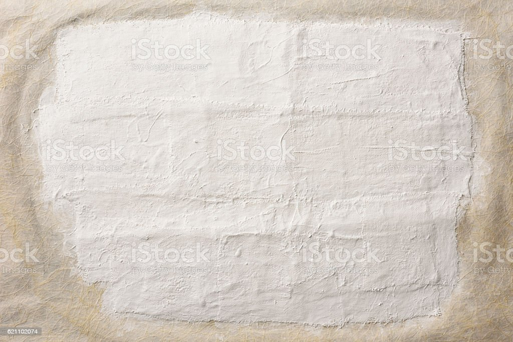 Close-up of plaster on beige rice paper stock photo