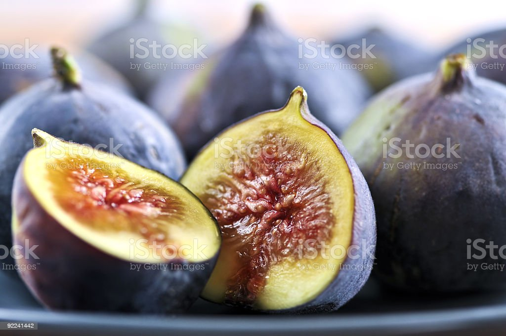 Close-up of plate of figs with one sliced in half stock photo