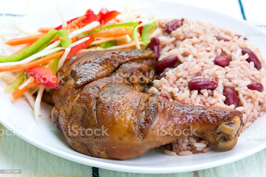 Close-up of plated Caribbean style jerked chicken with rice royalty-free stock photo