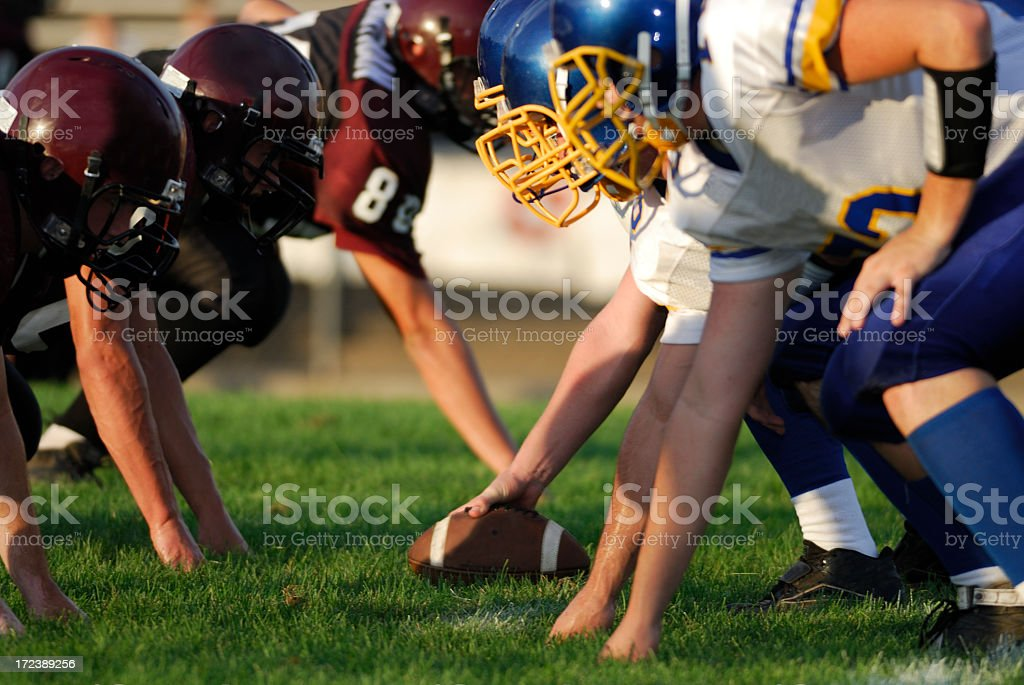 Close-up of players ready to start on American football game royalty-free stock photo