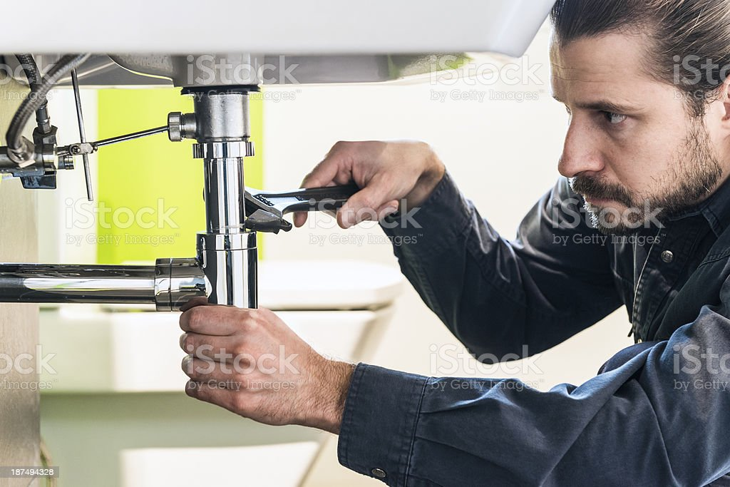 Close-up of plumber at work royalty-free stock photo