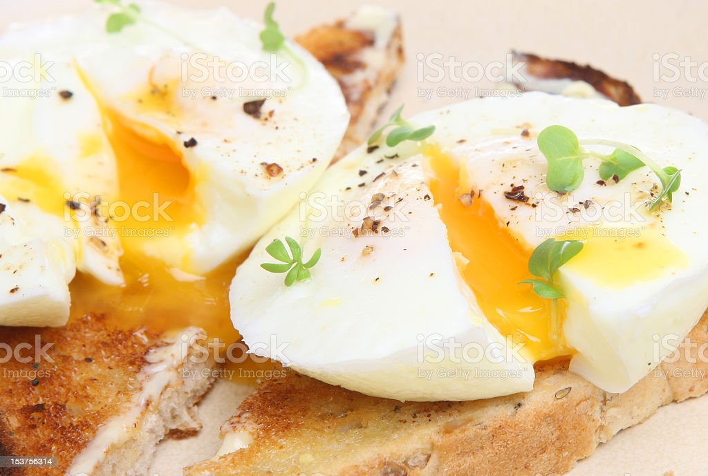 Close-up of poached eggs on toast stock photo