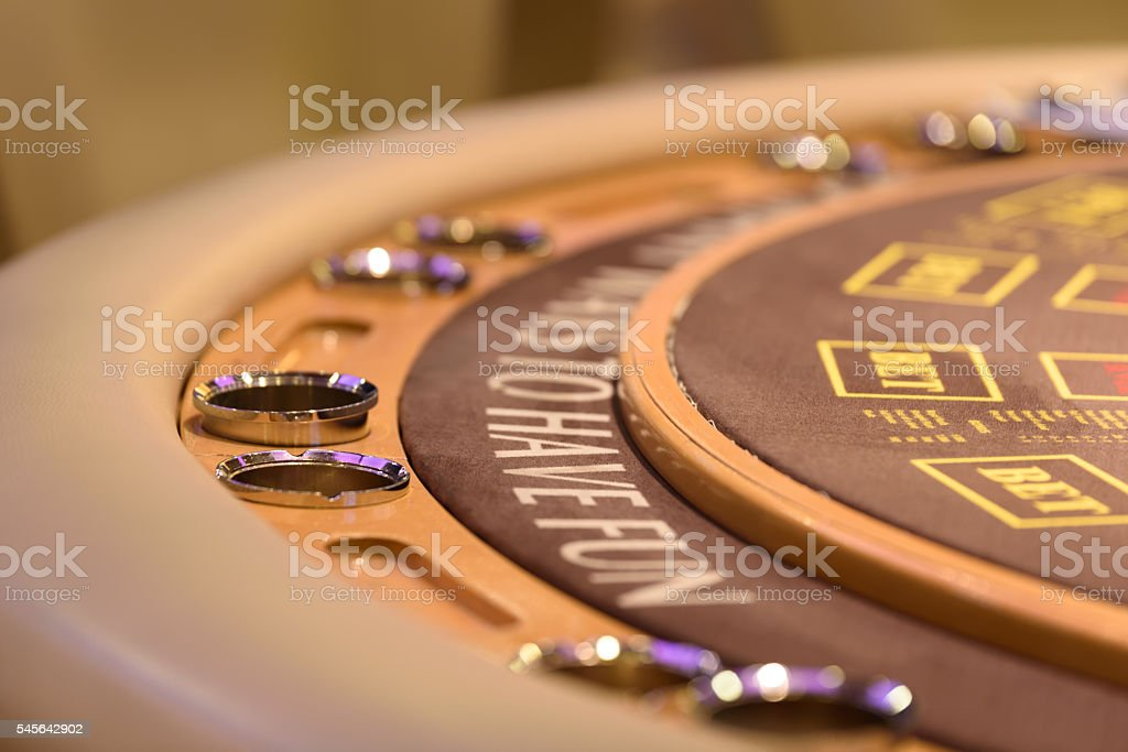 closeup of poker table with label to have fun stock photo
