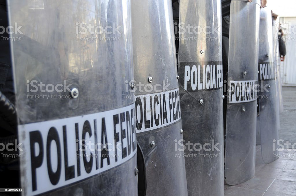 Closeup of police shields in Mexico stock photo