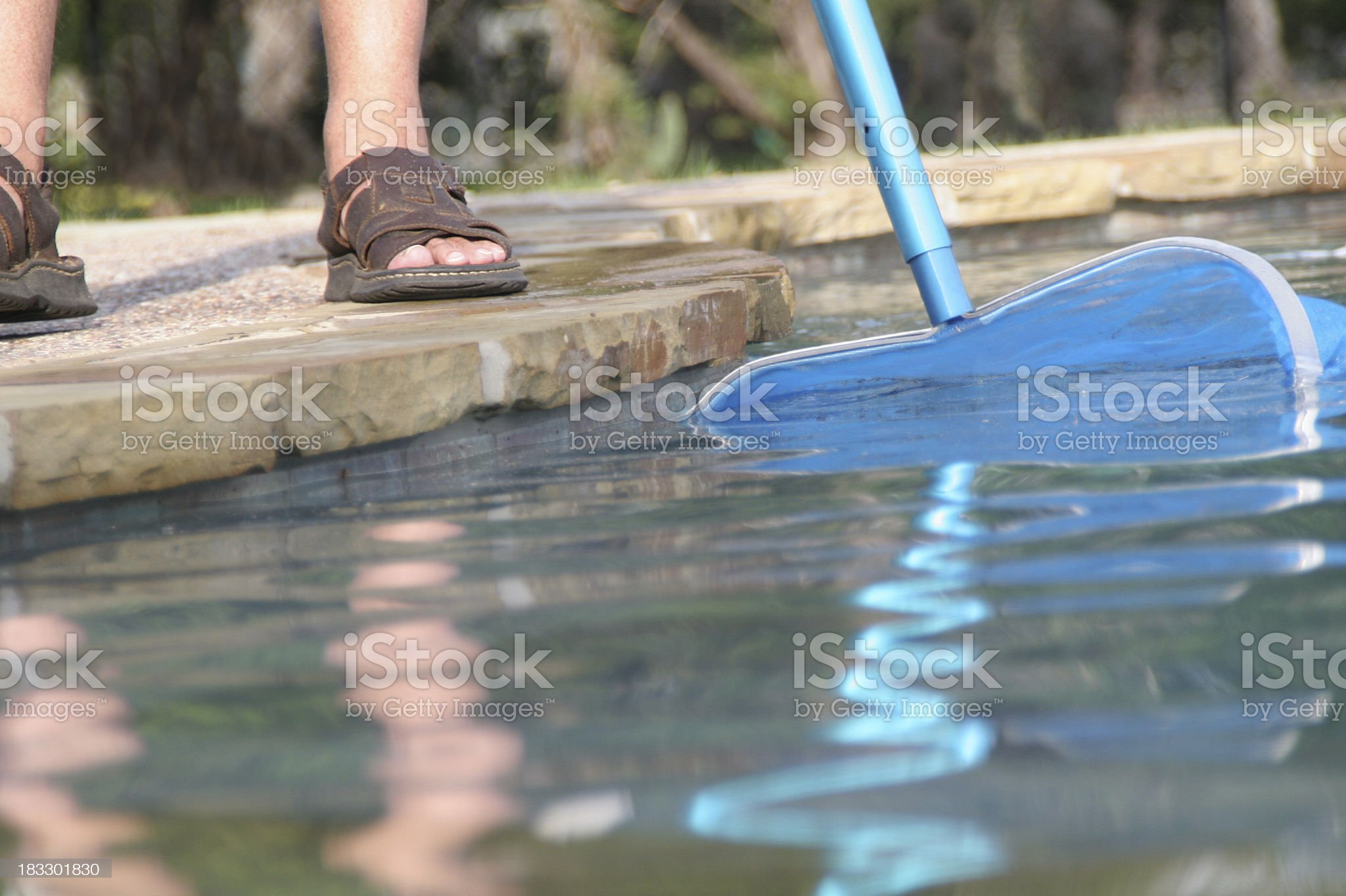 Close-up of pool guy doing pool maintenance royalty-free stock photo
