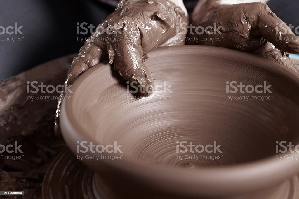 Close-up of potter's hands stock photo