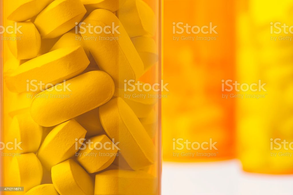 Close-Up of Prescription Medicine Bottles Containing Pills and Tablets stock photo