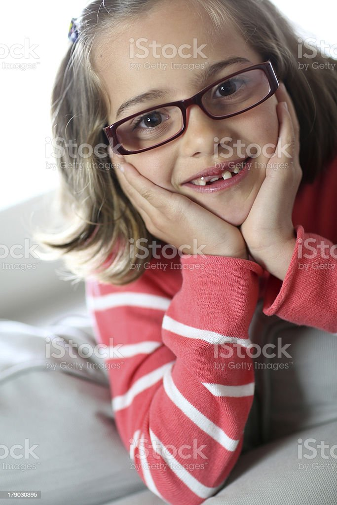 Closeup of pretty young girl sitting on couch royalty-free stock photo