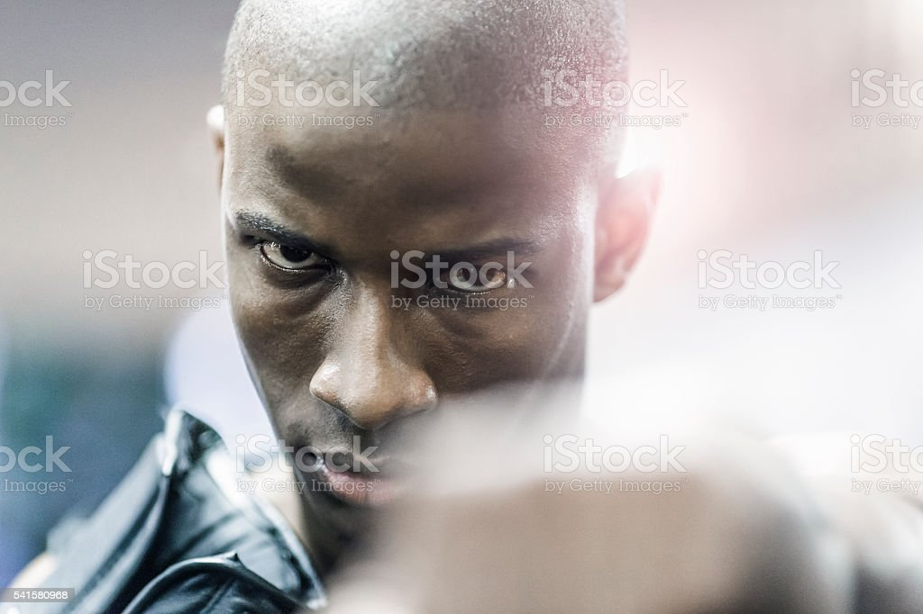 Close-up of proud boxer in gym stock photo