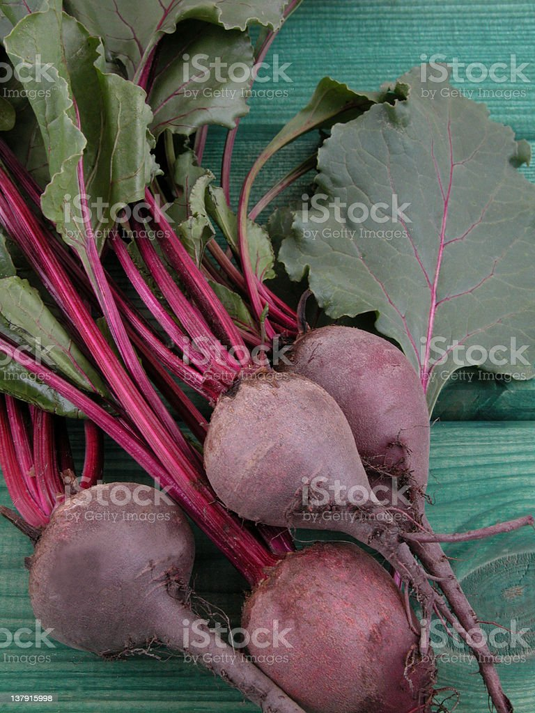 Close-up of purple beetroot over a green wooden background royalty-free stock photo