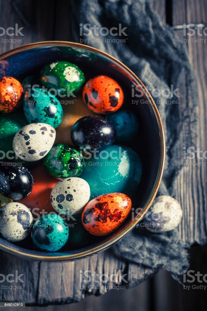 Closeup of quail and hen Easter eggs stock photo