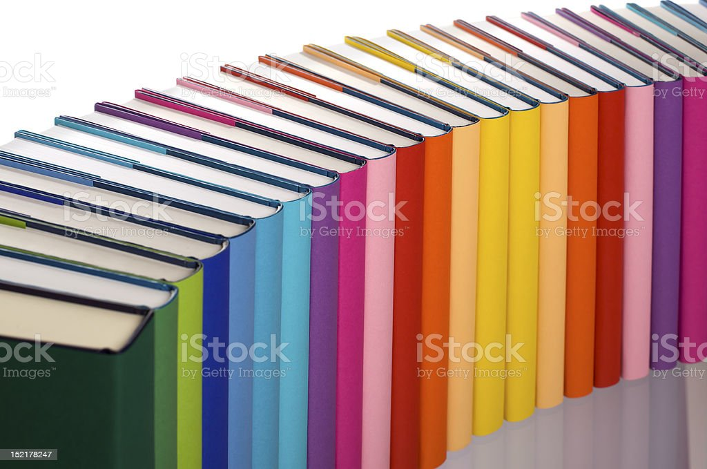 Close-up of rainbow-colored book arrangement royalty-free stock photo