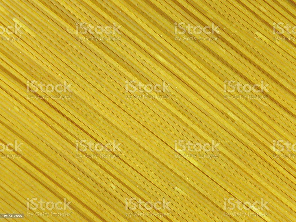 Close-up of raw whole wheat spaghetti, Background, Pattern, Texture stock photo