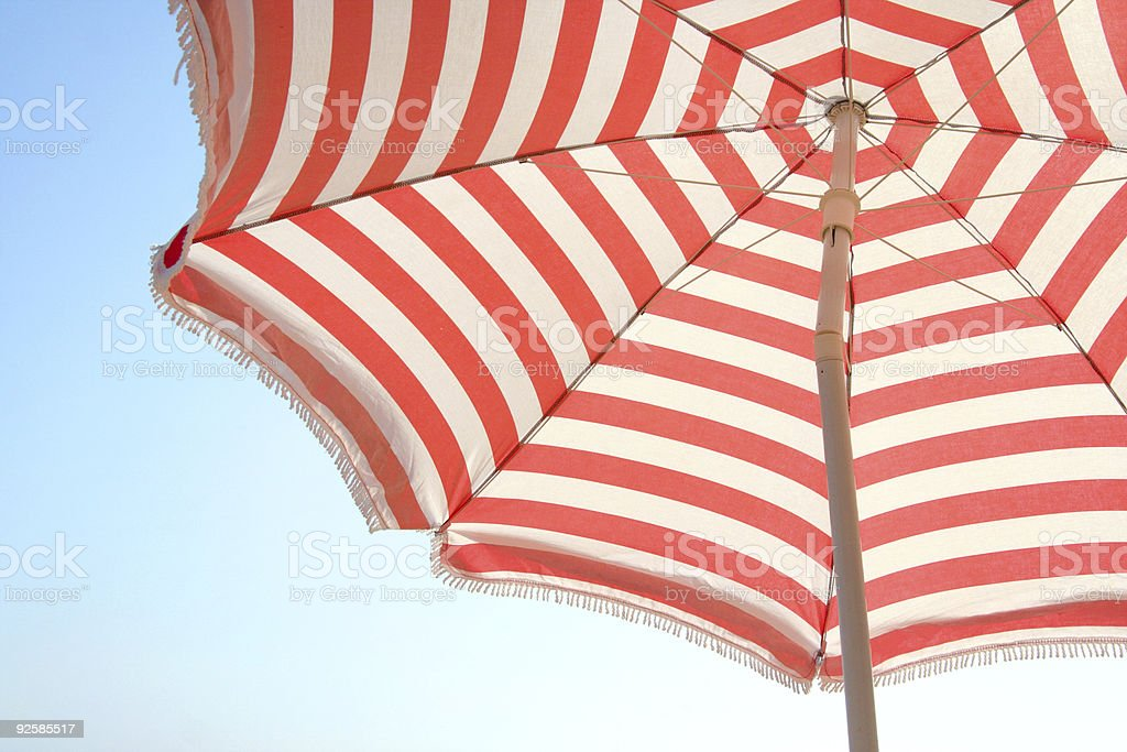 Close-up of red and white striped beach umbrella stock photo