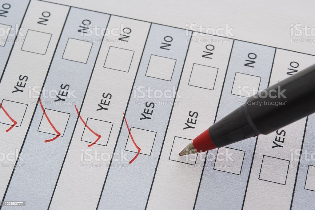 Close-up of red ball point pen marking a checkbox stock photo