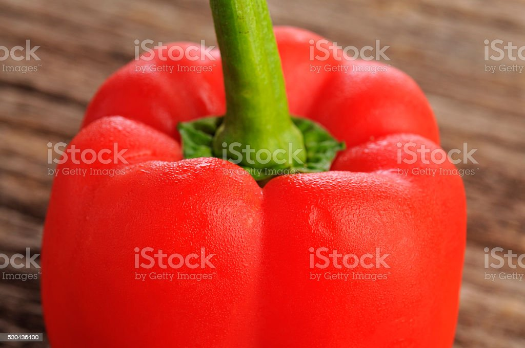 Close-up of Red Bell Pepper On Isolated Wooden Background stock photo
