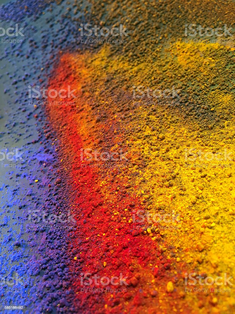 Close-up of red blue yellow pigment powder stock photo