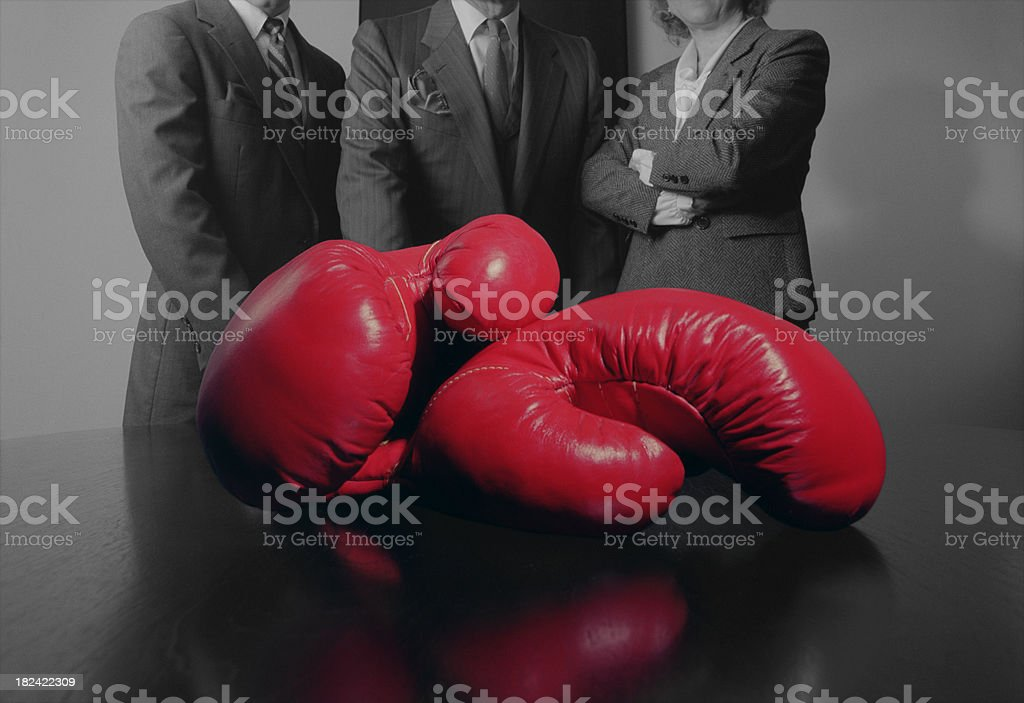 Close-up of Red Boxing Gloves with Business Persons stock photo