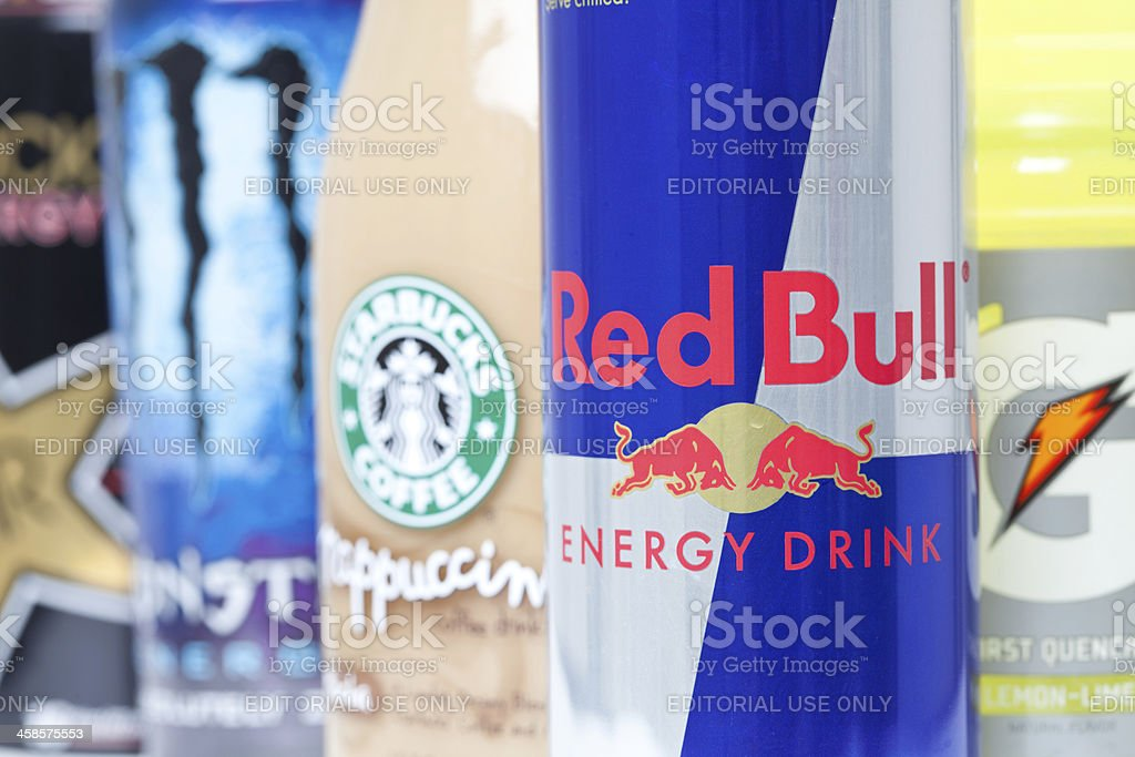 Closeup of Red Bull and Other Energy Drinks stock photo