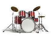 Close-up of red drum set on white background