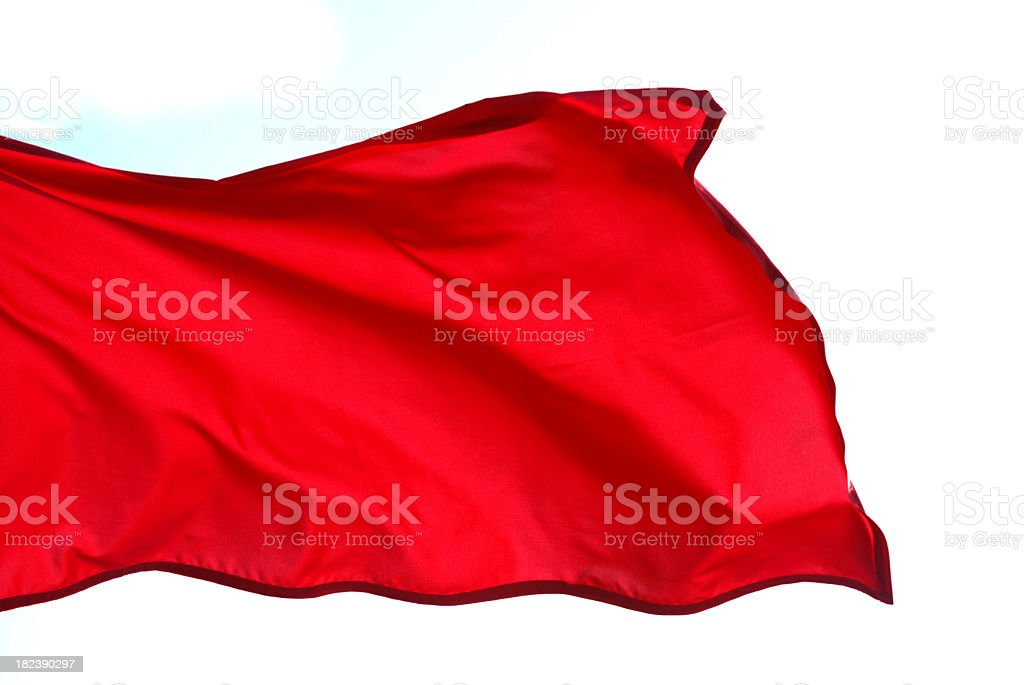 Close-up of red flag waving on white background stock photo