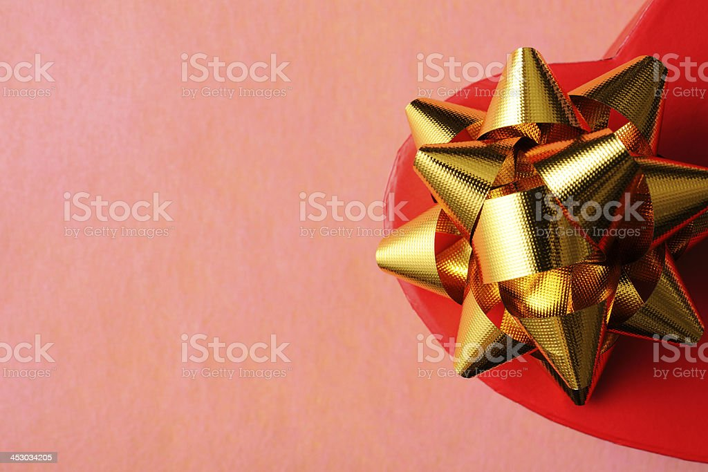 Close-up of red heart shape gift box with gold ribbon royalty-free stock photo