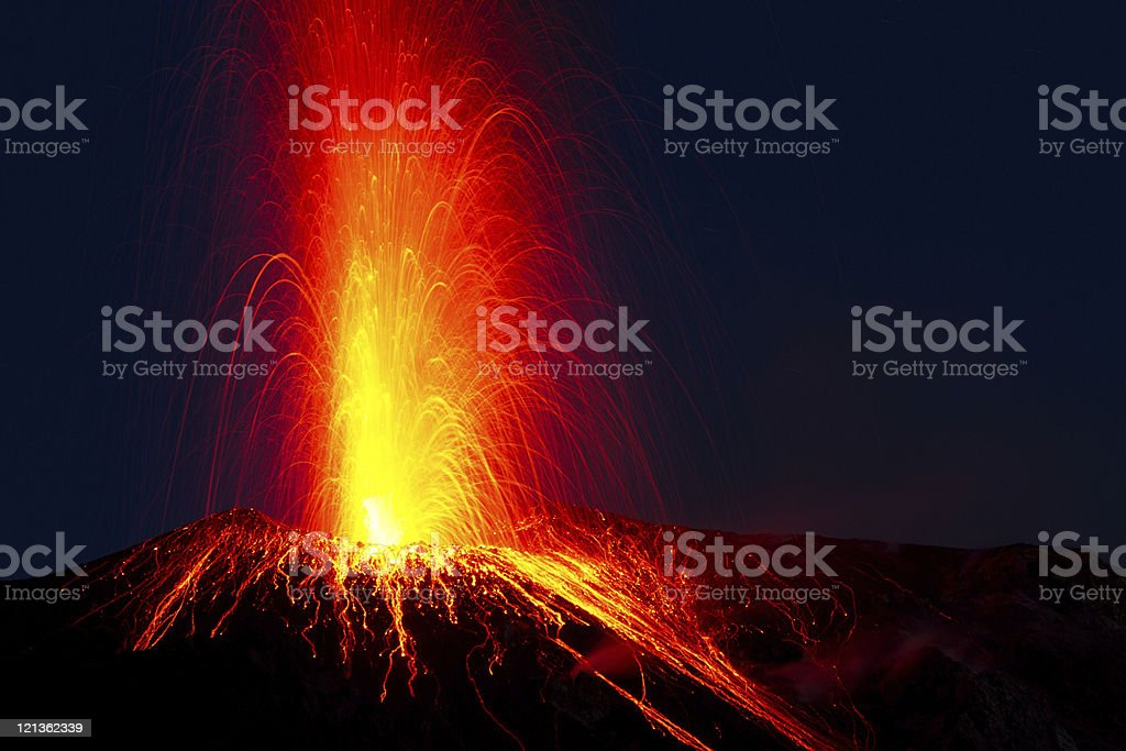 Close-up of red lava spewing from Stromboli volcano erupting stock photo