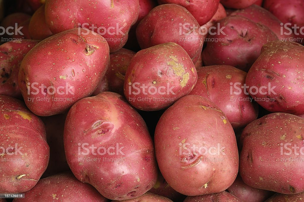 Close-up of Red Potatoes on Display in a Produce Market stock photo